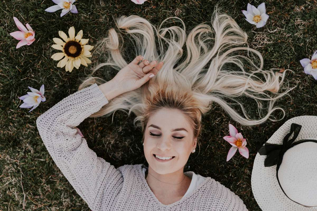woman lying on flowers and dreaming