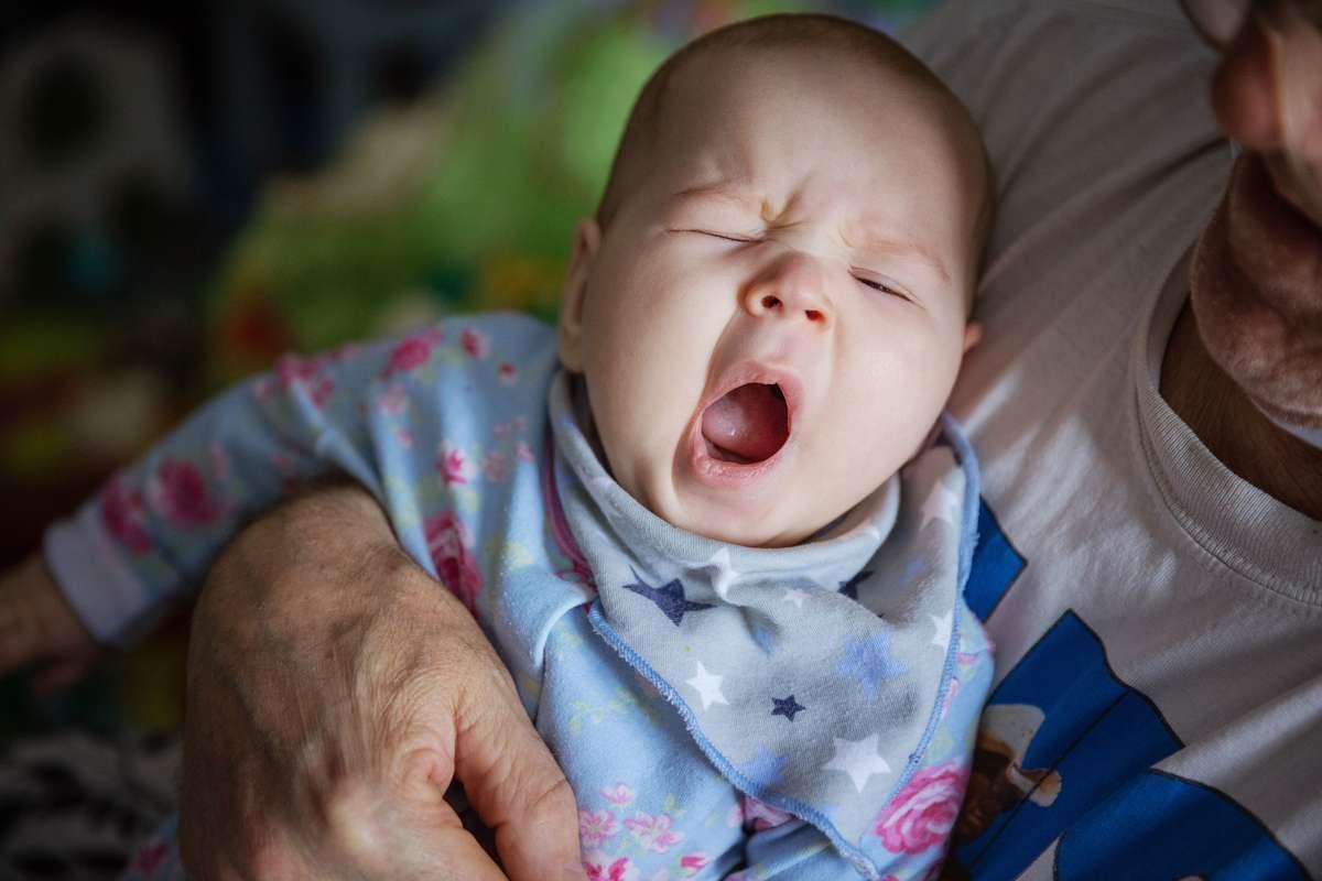 A cute baby yawning