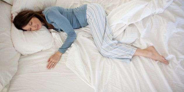 A Girl sleeping on a memory foam mattress